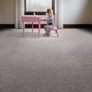 Girl playing piono on carpet flooring | Flooring By Design
